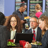 Executives Meeting Over Lunch Stock Photos