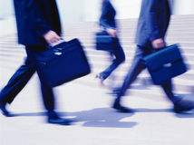 Executives moving quickly. With motion blur Stock Photo