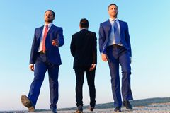 Executives present differences in views. Businessmen with confident faces. Board of executives present differences in views. Businessmen with confident faces in royalty free stock photo