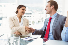 Executives shaking hands in board room meeting Stock Photos