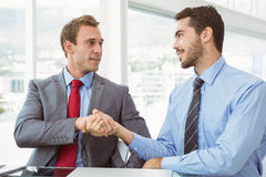 Executives shaking hands in board room meeting Stock Photography