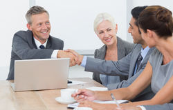 Executives shaking hands in board room meeting. At office royalty free stock image