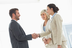 Executives shaking hands after a business meeting Royalty Free Stock Photography