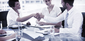 Executives shaking hands after a business meeting Stock Photo