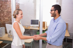 Executives shaking hands in office Royalty Free Stock Photos