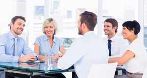 Executives sitting around conference table Royalty Free Stock Photography