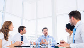 Executives sitting around conference table stock photo