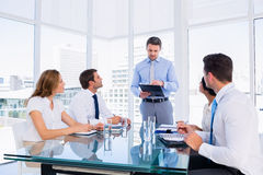 Executives sitting around conference table Royalty Free Stock Photo