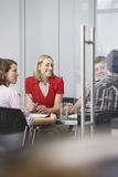 Executives Sitting At Conference Table Royalty Free Stock Photography