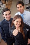 Executives with thumbs up Royalty Free Stock Photo