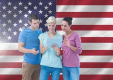 Executives using digital tablet against american flag. Digital composite image of executives using digital tablet against american flag royalty free stock images