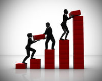 Executives working on a Bar Chart in teamwork Royalty Free Stock Images