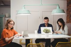Executives working at desk. In office stock images