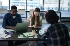 Executives working together in office Royalty Free Stock Image