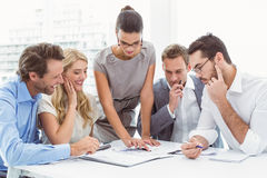Executives writing notes in office. Young business people writing notes in office royalty free stock images
