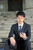 Executivo asiático esclarecido 14 da tecnologia foto de stock