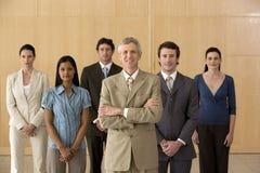 Executivo com sua equipe Fotografia de Stock