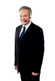 Executivo do centro de atendimento que levanta com auriculares Imagens de Stock Royalty Free