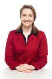 Executivo empresarial seguro que pisca um sorriso Imagens de Stock Royalty Free