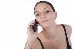 Executivo fêmea bonito que usa o telefone móvel Imagem de Stock Royalty Free