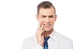 Executivo masculino com dor de dente Imagem de Stock
