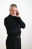 Executivo no telefone de pilha fotografia de stock