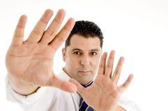 Executivo que mostra suas palmas Imagem de Stock Royalty Free