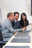 Executivos alegres no trabalho Foto de Stock