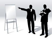 Executivos com um flipchart Fotografia de Stock Royalty Free