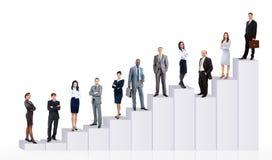Executivos da equipe e o diagrama Imagens de Stock Royalty Free