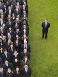 Executivos de By Group Of do homem de negócios na fileira fotografia de stock royalty free