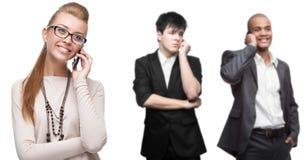 Executivos de sorriso felizes que chamam pelo celular Foto de Stock Royalty Free