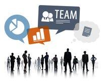 Executivos dos trabalhos de equipa com símbolos do negócio Foto de Stock