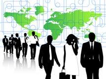 Executivos e mapa Imagem de Stock Royalty Free