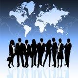 Executivos e mapa de mundo Foto de Stock
