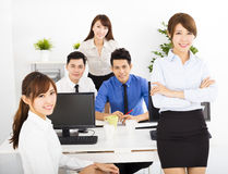 Executivos felizes que trabalham no escritório Imagem de Stock Royalty Free