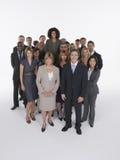 Executivos multi-étnicos com mulher de negócios Standing Taller Fotografia de Stock Royalty Free