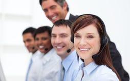 Executivos positivos que trabalham em um centro de chamadas Fotografia de Stock Royalty Free