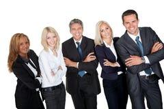 Executivos que estão com as mãos dobradas foto de stock