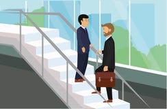 Executivos que estão na fala das escadas ilustração stock