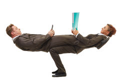 Executivos que levantam na pose acrobática difícil Foto de Stock Royalty Free