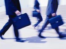 Executivos que movem-se rapidamente foto de stock