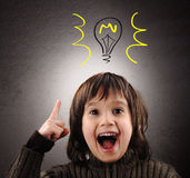 Exellent idea, kid with illustrated bulb stock photography