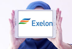 Exelon energy company logo. Logo of energy and home services company exelon on samsung tablet holded by arab muslim woman royalty free stock image