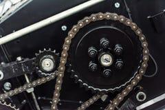 Exempel av kugghjulet och axeln för chain drev Arkivbild