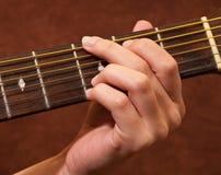 Exemple de leçon de guitare Photographie stock libre de droits