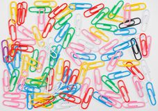 Exempted Colorful paper clips on white background stock photos