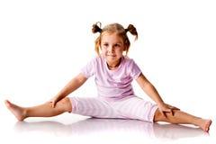 Exercício bonito da menina Fotografia de Stock Royalty Free