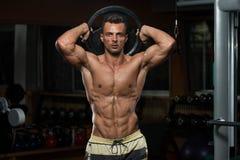 Exercício do tríceps com peso Imagens de Stock Royalty Free