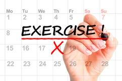 Exercício escrito no calendário foto de stock